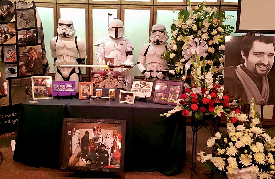 "...and I had the honor of being invited back to stand guard as a stormtrooper at Daniel's funeral. My mom and sister made the black ""DF"" arm bands for only for the troopers that attended the funeral."