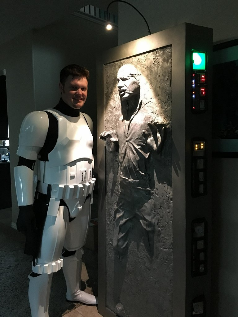 Me and my completed Han-in-Carbonite build. Roughly 200lbs of Bondo, wood, and resin. Arduino-powered animated control panels.